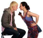 夫妇与年轻人战斗 免版税库存照片