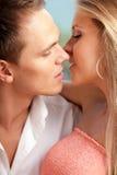 夫妇亲吻爱恋准备 库存图片
