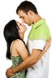 夫妇亲吻的年轻人 免版税库存图片