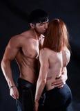 年轻夫妇亲吻 库存照片