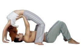 夫妇人女子瑜伽 免版税图库摄影