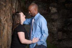 夫妇人种间微笑 图库摄影