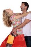夫妇兴高采烈拥抱 库存图片