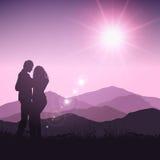 夫妇剪影在风景的 免版税库存图片