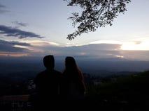 夫妇和日落 图库摄影