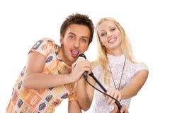 夫妇唱歌年轻人 免版税库存照片