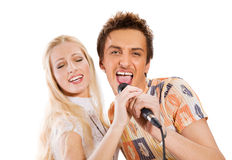 夫妇唱歌年轻人 库存照片
