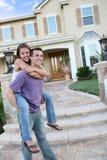 夫妇回家年轻人 库存照片
