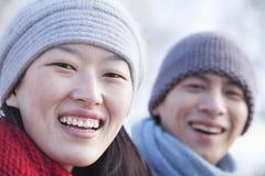 年轻夫妇在北京在冬天,关闭在面孔 图库摄影