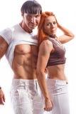 年轻夫妇在白色背景的演播室 免版税图库摄影