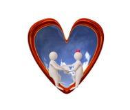 夫妇在红色心脏 图库摄影
