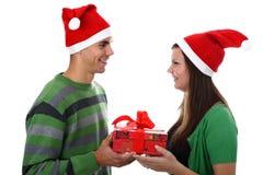 夫妇帽子查出圣诞老人佩带的空白年&# 免版税库存照片