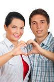 夫妇形成他们现有量的重点 免版税库存图片