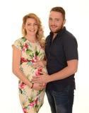 夫妇怀孕微笑 免版税库存照片
