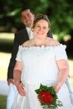 夫妇怀孕的婚礼 库存照片