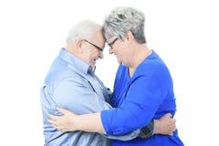 夫妇愉快的爱前辈 查出在白色 库存图片
