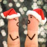 夫妇手指艺术庆祝圣诞节 免版税图库摄影