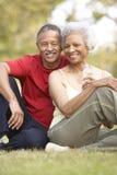 夫妇执行休息的前辈 免版税库存照片