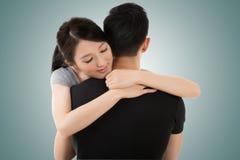 夫妇拥抱和舒适 库存照片