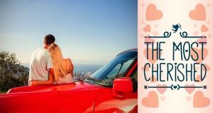 夫妇拥抱和赞赏的全景背面图的综合图象  图库摄影