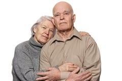 夫妇拥抱的愉快的纵向前辈 库存图片