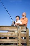 夫妇捕鱼乐趣前辈 免版税库存图片