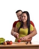 夫妇正餐愉快的准备的年轻人 免版税库存照片