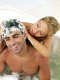 夫妇淋浴采取年轻人 库存照片
