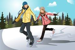 夫妇滑冰年轻人 皇族释放例证