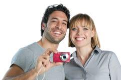 夫妇照片微笑的采取 免版税图库摄影