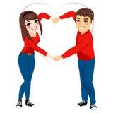 夫妇爱形状胳膊 免版税库存图片