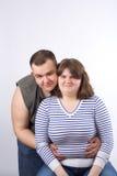 夫妇爱微笑的年轻人 免版税库存图片