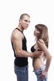 夫妇牛仔裤性感的年轻人 免版税图库摄影