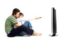 夫妇电视注意 免版税库存照片