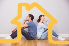 夫妇的综合图象一起坐地板 库存照片