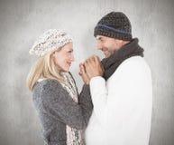 夫妇的综合图象在冬天塑造拥抱 库存图片