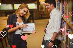 夫妇的综合图象在图书馆和华伦泰心脏3d 库存图片