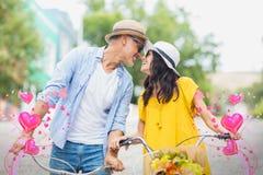 夫妇的综合图象在自行车和华伦泰心脏3d的 库存图片