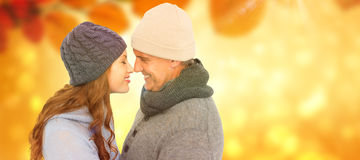 夫妇的综合图象在面对的温暖的衣物的 免版税库存照片