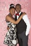 夫妇穿戴的当事人年轻人 免版税库存照片