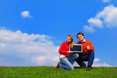 夫妇笔记本 免版税图库摄影