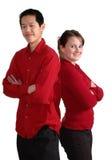 夫妇红色微笑 免版税图库摄影