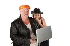 夫妇膝上型计算机 免版税图库摄影