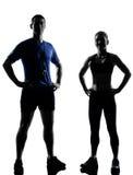 夫妇行使锻炼有氧辅导员的妇女人 免版税库存照片