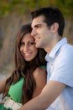 夫妇计时在海滩 免版税库存图片