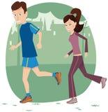 夫妇跑步的公园 免版税库存图片