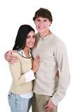 夫妇递愉快的藏品微笑的年轻人 免版税库存照片