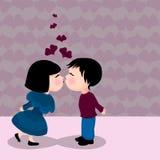 夫妇逗人喜爱亲吻 免版税库存照片