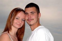 夫妇面对年轻人 免版税图库摄影