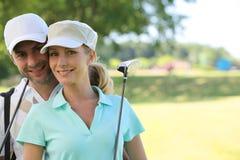 夫妇高尔夫球运动员 库存照片